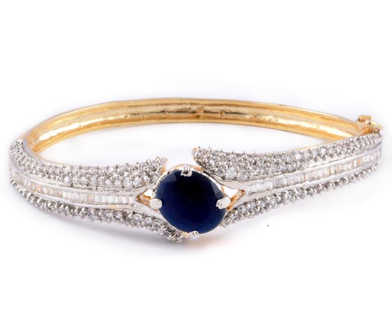 Vogue Crafts & Designs Pvt. Ltd. manufactures Golden Bracelet with Topaz stone at wholesale price.