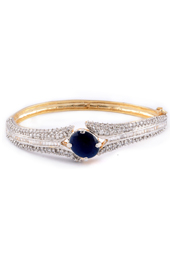 Vogue Crafts and Designs Pvt. Ltd. manufactures Golden Bracelet with Topaz stone at wholesale price.