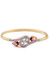 Vogue Crafts and Designs Pvt. Ltd. manufactures Golden Bracelet with Pink Trumulin stones at wholesale price.