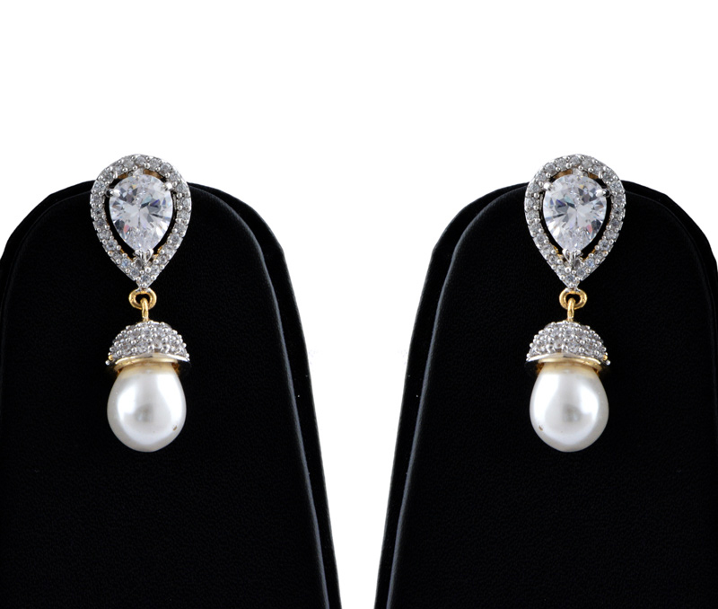 Vogue Crafts & Designs Pvt. Ltd. manufactures Pearl Drop American Diamond Earrings at wholesale price.