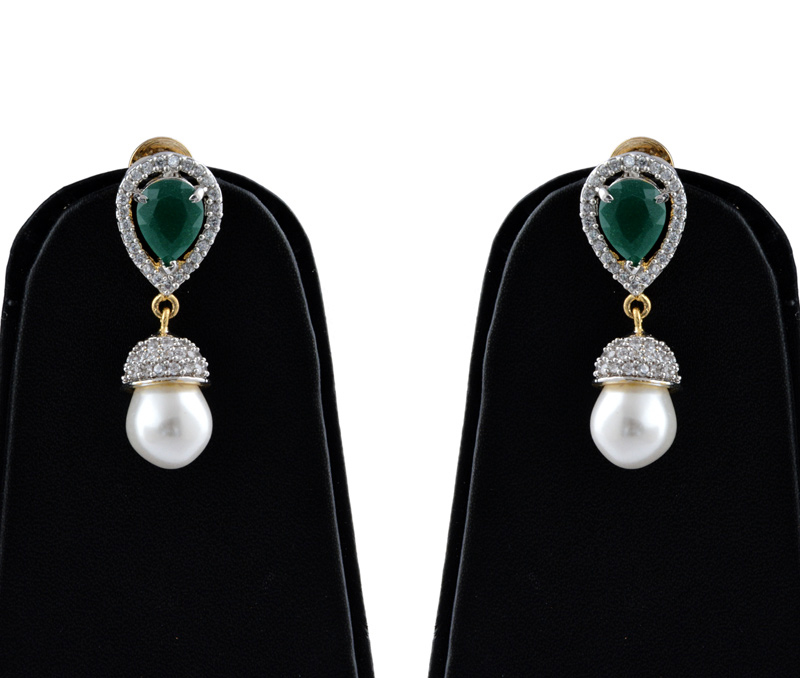 Vogue Crafts & Designs Pvt. Ltd. manufactures Brass American Diamond Earrings with Emerald at wholesale price.