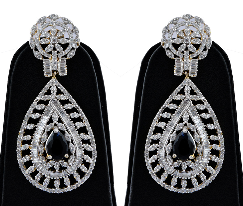 Vogue Crafts & Designs Pvt. Ltd. manufactures Brass American Diamond Earrings with Topaz at wholesale price.
