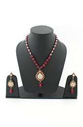 Vogue Crafts and Designs Pvt. Ltd. manufactures Kundan-Meena work Necklace Earrings set at wholesale price.
