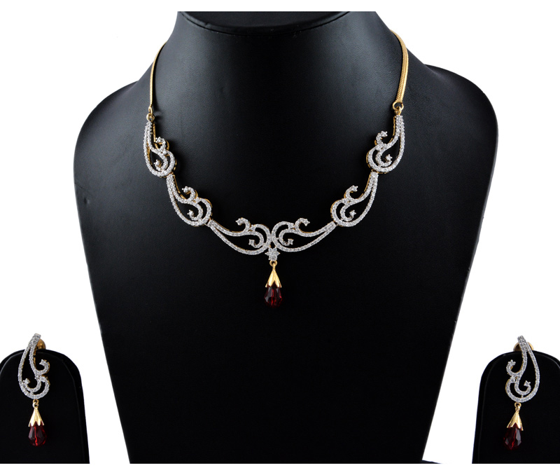 Vogue Crafts & Designs Pvt. Ltd. manufactures American Diamonds with Maroon Stone Earrings-Necklace set at wholesale price.