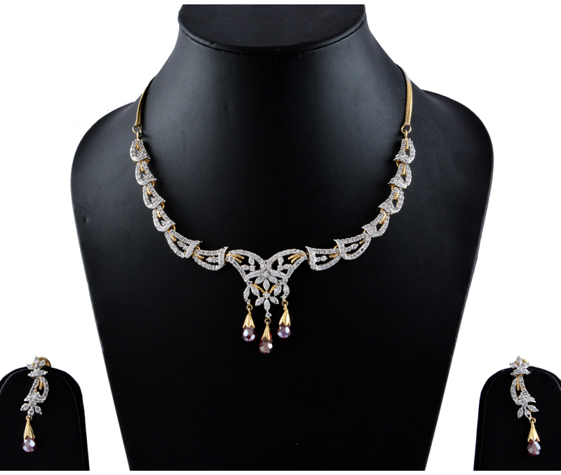 Vogue Crafts & Designs Pvt. Ltd. manufactures American Diamonds with Rubi Earrings-Necklace set at wholesale price.