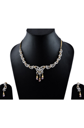 Vogue Crafts and Designs Pvt. Ltd. manufactures American Diamonds with Rubi Earrings-Necklace set at wholesale price.
