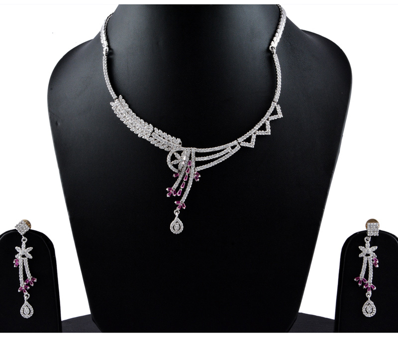 Vogue Crafts & Designs Pvt. Ltd. manufactures American Diamonds Dark Pink Necklace Earrings set at wholesale price.