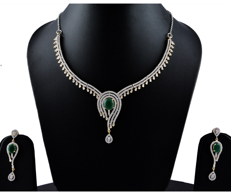 Vogue Crafts & Designs Pvt. Ltd. manufactures The Emerald Charm Earrings-Necklace set at wholesale price.