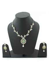 Vogue Crafts and Designs Pvt. Ltd. manufactures Emerald and Diamonds Earrings-Necklace set at wholesale price.