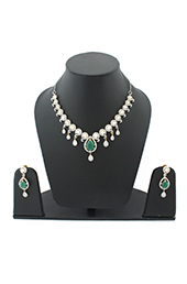 Vogue Crafts and Designs Pvt. Ltd. manufactures Pearly Emerald Earrings-Necklace set at wholesale price.