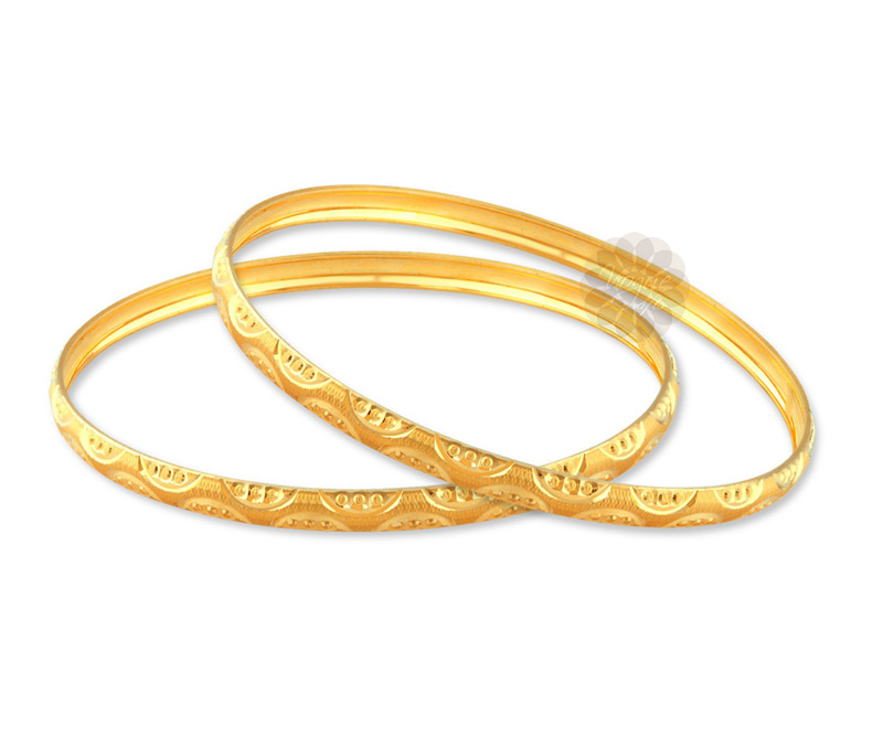 Latest Design Jewelry - Gracefully Patterned Golden Bangles .