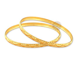 Gracefully Patterned Golden Bangles