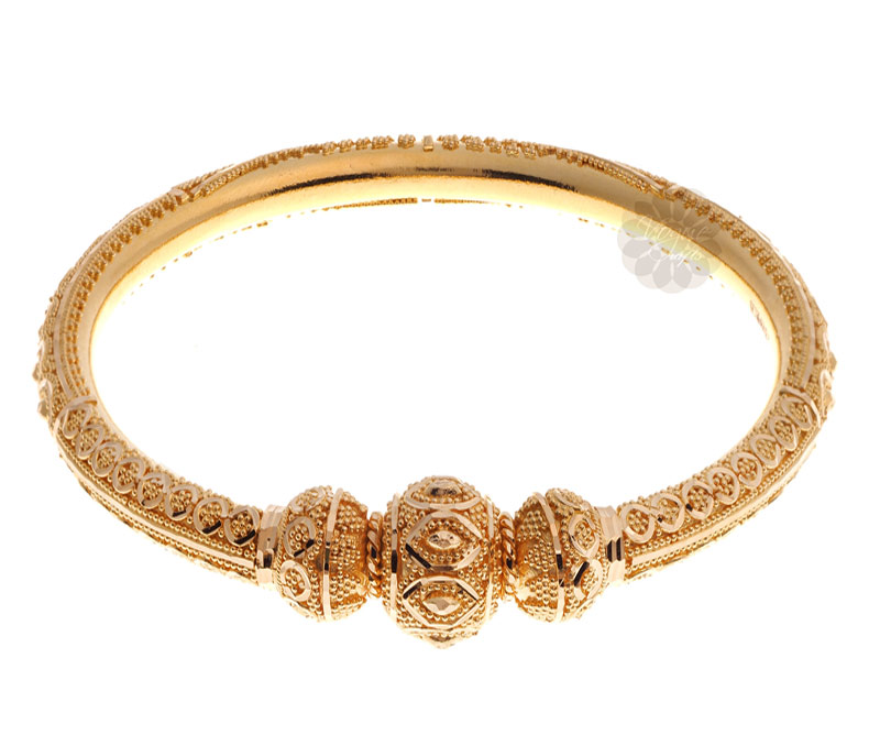 Vogue Crafts & Designs Pvt. Ltd. manufactures Exquisite Traditional Golden Bangle at wholesale price.