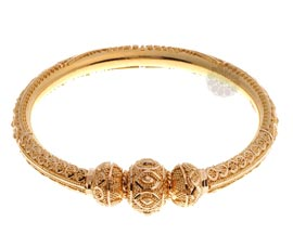 Vogue Crafts and Designs Pvt. Ltd. manufactures Exquisite Traditional Golden Bangle at wholesale price.