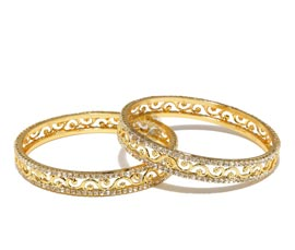 Vogue Crafts and Designs Pvt. Ltd. manufactures Eternal Treasure Pair of Bangles at wholesale price.