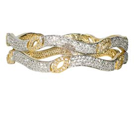 Vogue Crafts and Designs Pvt. Ltd. manufactures Single-lined Ultimate Pair of Bangles at wholesale price.