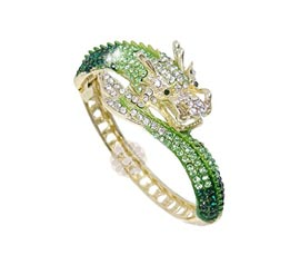 Vogue Crafts and Designs Pvt. Ltd. manufactures Outrageous Dragon Flare Golden Cuff at wholesale price.