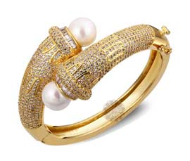 Vogue Crafts and Designs Pvt. Ltd. manufactures Cuff with Pearls at wholesale price.