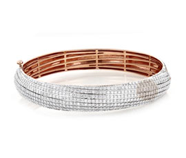 Vogue Crafts and Designs Pvt. Ltd. manufactures Sophisticated Stone Studded Cuff at wholesale price.