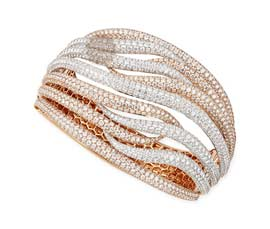 Vogue Crafts and Designs Pvt. Ltd. manufactures Bright Light Golden Cuff at wholesale price.