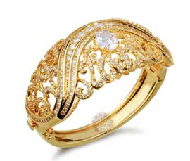 Vogue Crafts and Designs Pvt. Ltd. manufactures Galaxy of Stones Golden Handcuff at wholesale price.