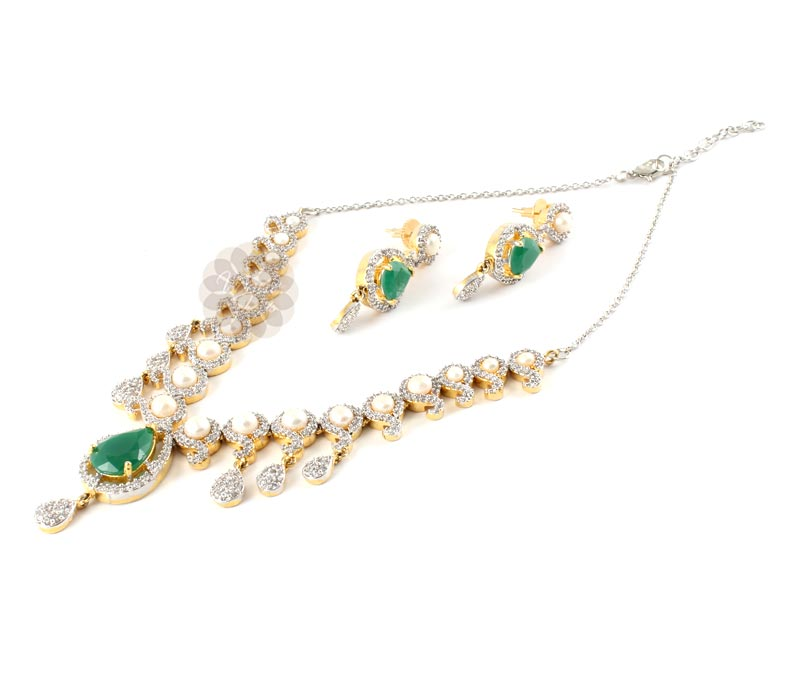 Vogue Crafts & Designs Pvt. Ltd. manufactures Pearly Emerald Earrings-Necklace set at wholesale price.