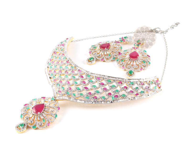 Vogue Crafts & Designs Pvt. Ltd. manufactures Pearls Rubi and Emerald Earrings-Necklace set at wholesale price.