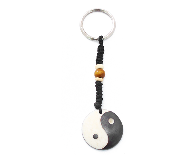Vogue Crafts & Designs Pvt. Ltd. manufactures Carved Wheel Keyring at wholesale price.