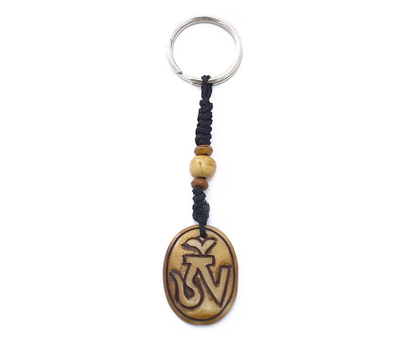 Vogue Crafts & Designs Pvt. Ltd. manufactures Oval Om Keyring at wholesale price.