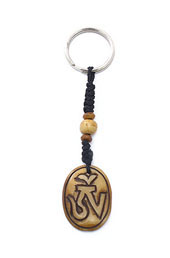 Vogue Crafts and Designs Pvt. Ltd. manufactures Oval Om Keyring at wholesale price.