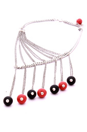 Vogue Crafts and Designs Pvt. Ltd. manufactures Drops of Red and Black Necklace at wholesale price.