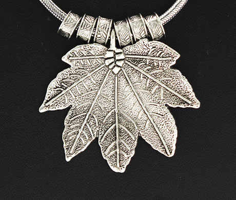 Vogue Crafts & Designs Pvt. Ltd. manufactures Maple Leaf Silver Pendant at wholesale price.