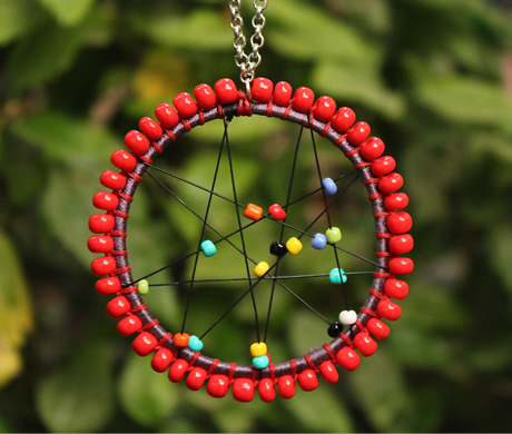 Vogue Crafts & Designs Pvt. Ltd. manufactures The Circle of Red Pendant at wholesale price.