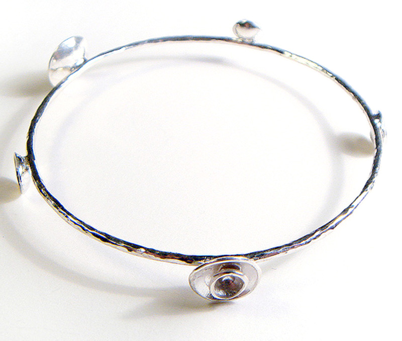 Vogue Crafts & Designs Pvt. Ltd. manufactures Scoops of Silver Bangle at wholesale price.