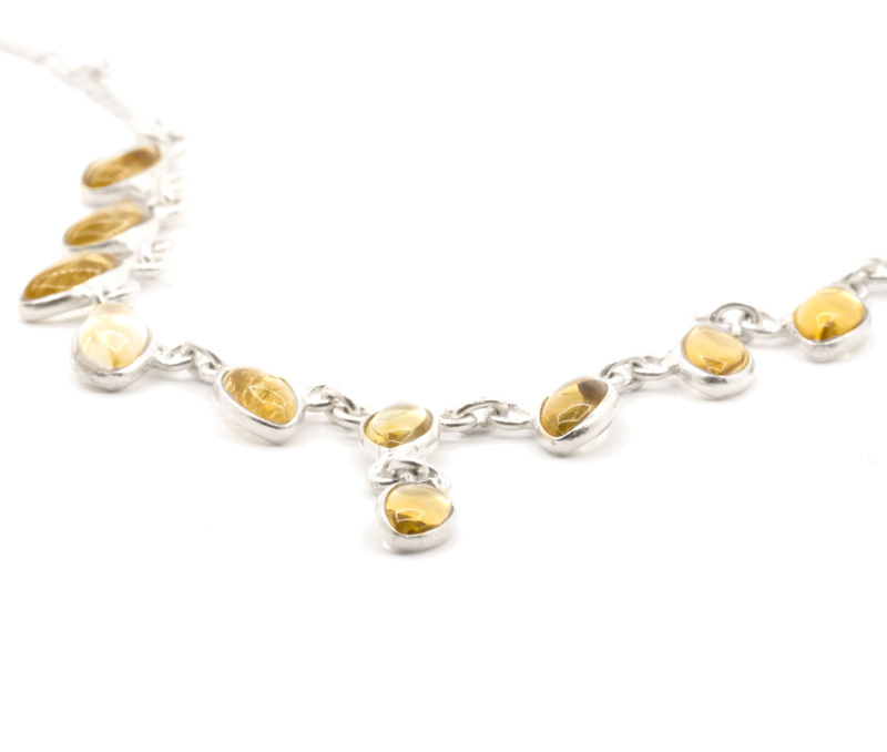 Vogue Crafts & Designs Pvt. Ltd. manufactures Golden Yellow Stone Silver Necklace at wholesale price.