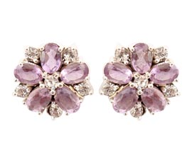 Vogue Crafts and Designs Pvt. Ltd. manufactures Floral Silver Stud Earrings at wholesale price.
