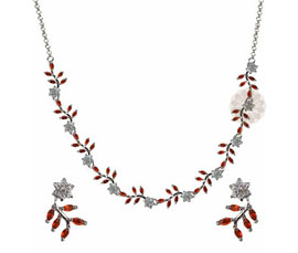 Vogue Crafts and Designs Pvt. Ltd. manufactures Floral Silver Necklace with Earrings at wholesale price.